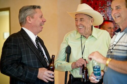 Mike Sexton and Doyle Brunson share a laugh.